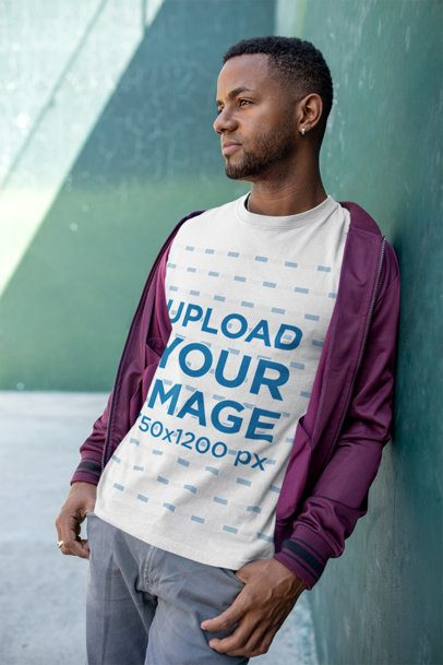 T-Shirt Mockup of a Man Leaning over a Wall in an Urban Environment 25930