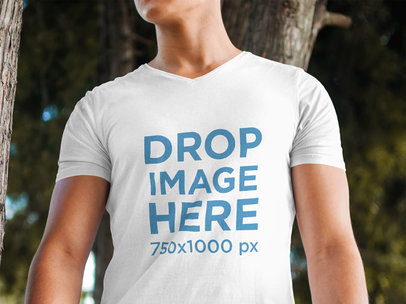 T-Shirt Mockup Featuring a Young Man at a Park a5557