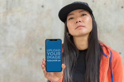 iPhone XS Mockup Featuring a Girl with Swag 25773