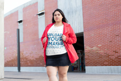 Plus Size Tee Mockup of a Bold Woman Posing by a Brick-Walled Bodega 25464