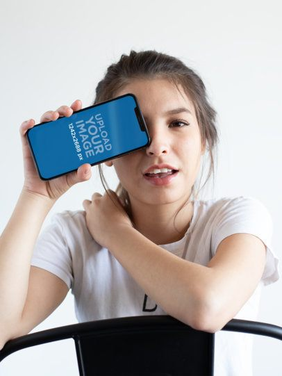 Mockup of a Girl Covering One Eye with Her iPhone XS Max 25826