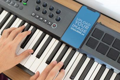 iPhone XS Max Mockup over a Piano Keyboard 25757