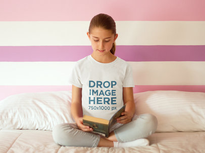 T-Shirt Mockup Featuring a Girl Reading a Book in Bed  a7936