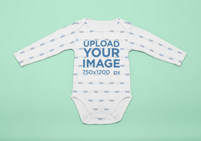Mockup of a Onesie Laid Flat on a Surface 25125