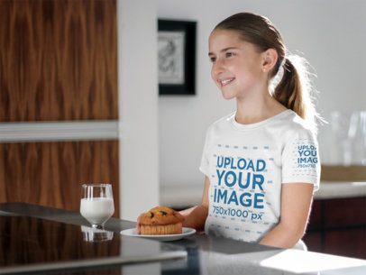 T-Shirt Mockup Featuring a Young Girl Having Breakfast a7935