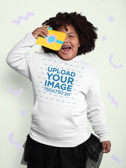 Plus Size Pullover Hoodie Mockup of a Girl Holding a Paper Camera 25586