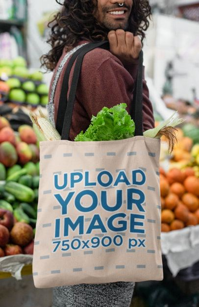 Mockup of a Long-Haired Man Carrying a Tote Bag on His Shoulder at a Food Market 26700