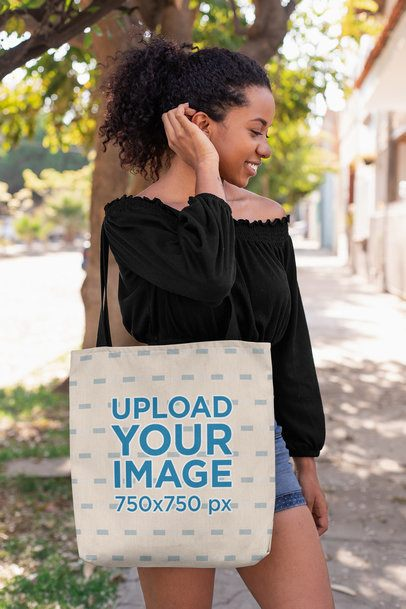 Tote Bag Mockup of a Woman Fixing Her Hair on a Street 26695
