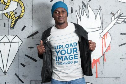 T-Shirt Mockup of a Man with a Beanie Standing by Wall Drawings 26434