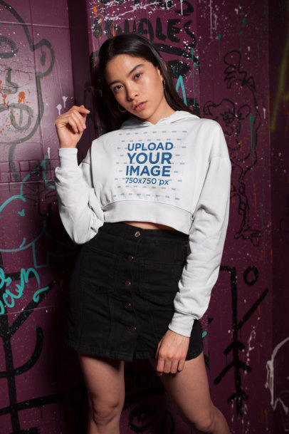 Crop Top Hoodie Mockup of a Pretty Girl Leaning on a Grafitti Wall 26093