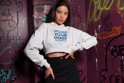 Crop Top Hoodie Mockup of an Audacious Girl Posing by Graffitied Walls 26094
