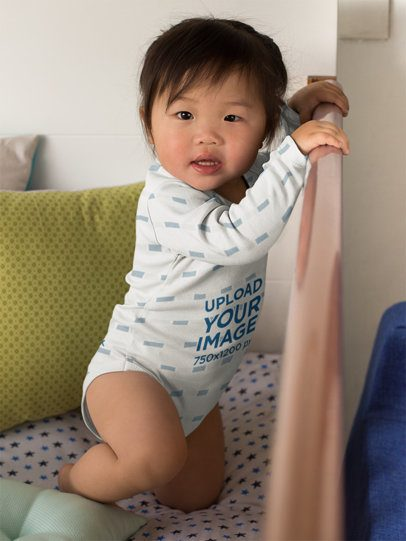 Onesie Mockup of a Cute Little Baby in Her Crib 25131