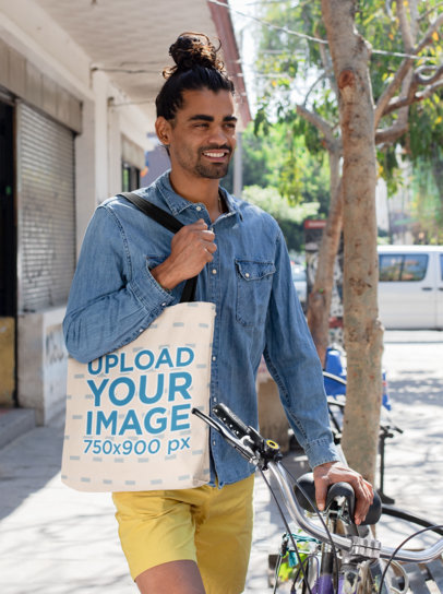 Tote Bag Mockup of a Smiling Man with a Hair Bun Next to His Bicycle  26705