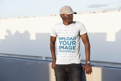 T-Shirt Mockup of a Man with a Cap Posing at Sunset 26634