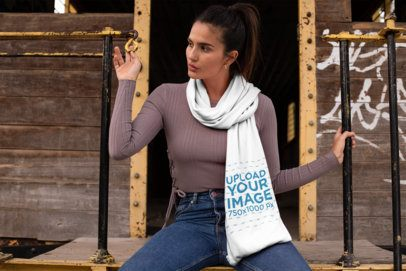 Scarf Mockup of a Girl with a Ponytail Sitting in an Old Rusty Wagon 25672
