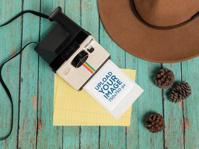 Polaroid Frame Mockup Next to a Hat and Some Pinecones 26153