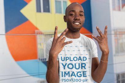 T-Shirt Mockup Featuring a Man Making Modern Hand Gestures 26364