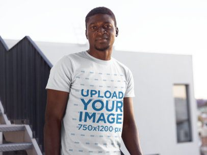 Mockup of a Man with Short Hair Wearing a T-Shirt in an Urban Scenario 26640