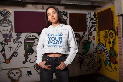 Mockup of a Cool Girl Wearing a Crop Top Hoodie at a Dive Bar 26104