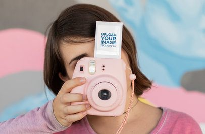 Instax Frame Mockup of a Woman Holding an Instant Camera 26291