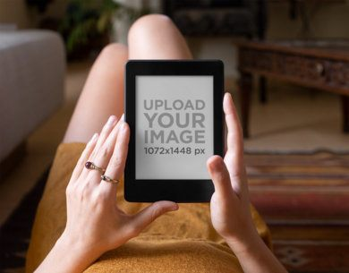 Kindle Paperwhite Mockup of a Woman Reading in Her Home 26084