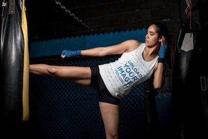 Tank Top Mockup of a Female MMA Fighter Kicking a Punching Bag 26260