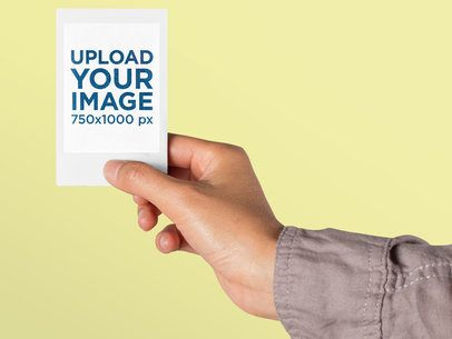 Mockup of an Instax Frame Picture Held Up Against a Colorful Backdrop 26175