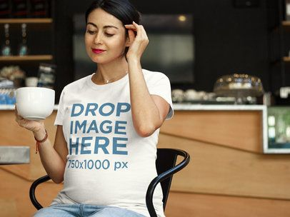 T-Shirt Mockup Featuring a Pregnant Woman at a Cafe a7963