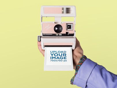 Mockup of a Polaroid Picture Frame Coming out of a Retro Camera 26161
