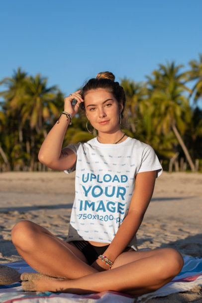 Tee Mockup of a Bronzed Woman Sitting by Palm Trees at the Beach 26802