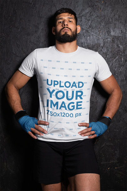 T-Shirt Mockup of an MMA Wrestler Against a Wall 26255