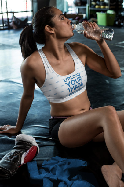 Sports Bra Mockup of a Female MMA Athlete Drinking Water at the Gym 26266