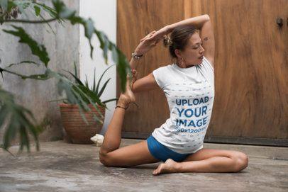 Tee Mockup of a Woman with a Hair Bun Doing Yoga 26849