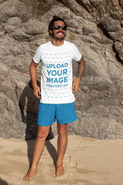 T-Shirt Mockup of a Smiling Long-Haired Man with Sunglasses Posing at the Beach 26765