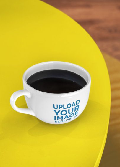 Coffee Mug Mockup Placed over a Table 26508
