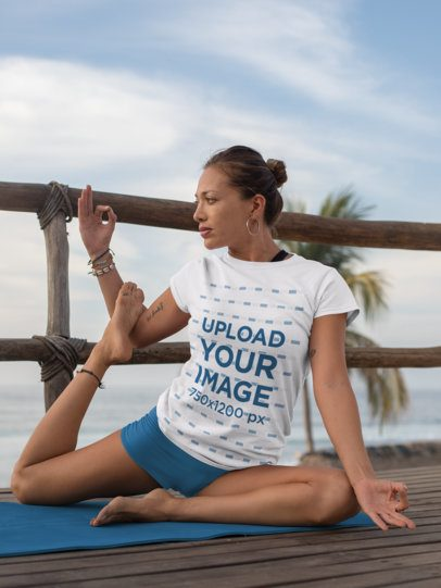 T-Shirt Mockup of a Woman Doing a Yoga Pose on a Dock 26855