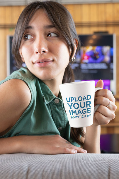Mockup of a Relaxed Woman Holding Her Coffee Cup 26452