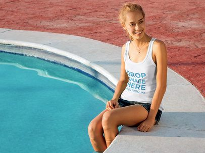 Young Smiling Woman Sitting by a Pool Tank Top Mockup a8009
