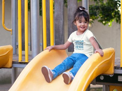 T-Shirt Mockup Featuring a Little Girl on a Slide at a Park a7677