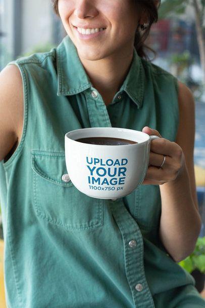 Mockup of a Big-Smiled Woman Holding a 24 oz Coffee Mug 26460