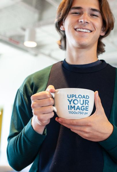 Mockup of a Smiling Man with Long Hair Holding a Coffee Mug 26514