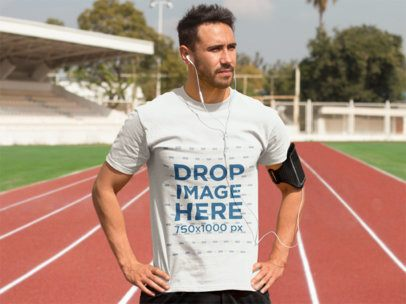 Athletic Man Exercising on a Track Field T-Shirt Mockup a8028