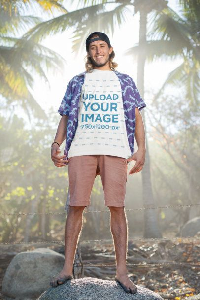 T-Shirt Mockup of a Beach-Attire Man Posing in the Light of Day 26764