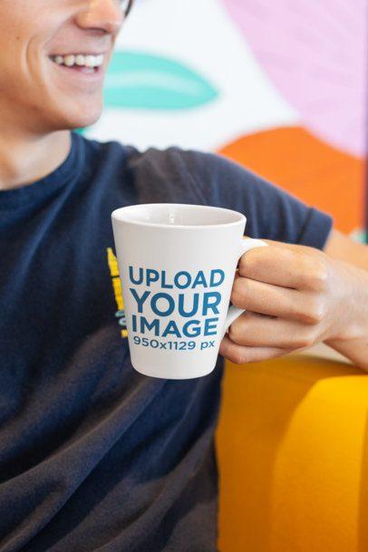 11 oz Coffee Mug Mockup of a Smiling Man in a Colorful Setting 26519