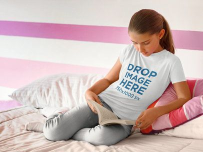 Young Girl Reading a Book in Bed T-Shirt Mockup a7927