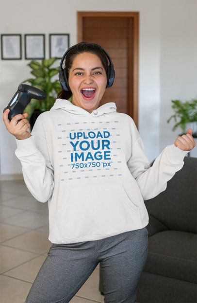 Pullover Hoodie Mockup of a Cheerful Gamer Woman in Her Living Room 26909