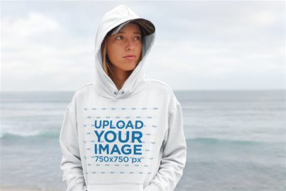 Pullover Hoodie Mockup of a Serious Woman Standing at the Beach 26829