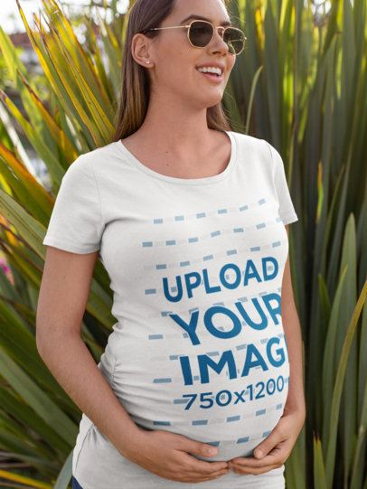 T-Shirt Mockup of a Pregnant Woman with Sunglasses Against Long Leaves 26663