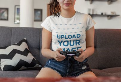 T-Shirt Mockup of a Female Gamer Playing in Her Living Room 26895