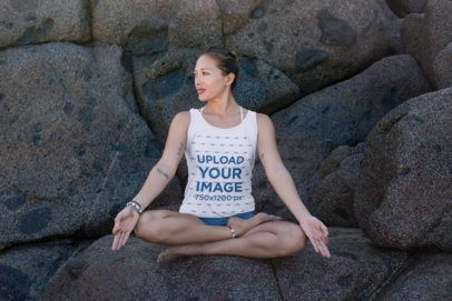 Tank Top Mockup of a Woman Sitting over a Rock in a Yoga Position 26827
